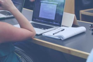Student sitting in front of screen